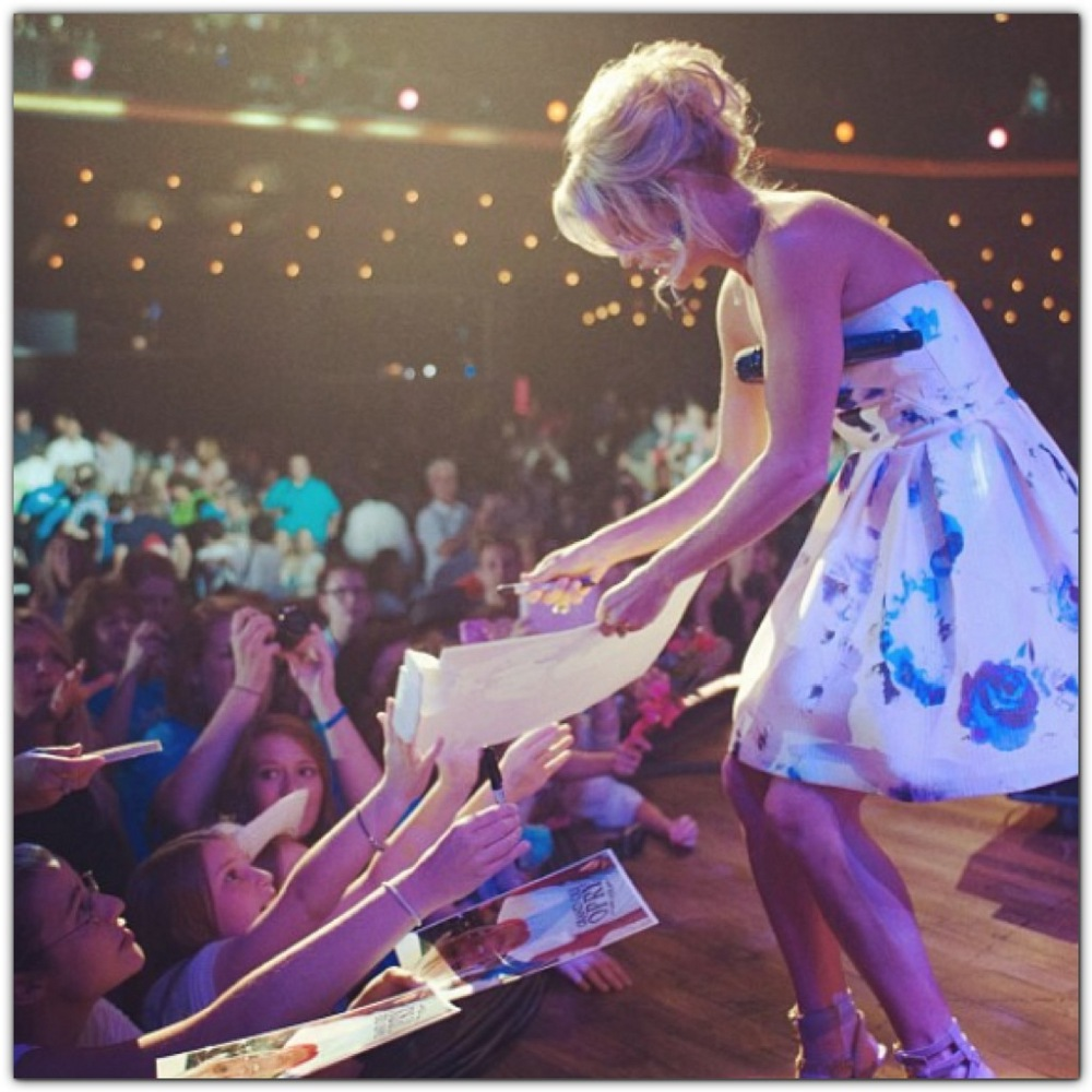 I didn't actually get to talk to Carrie, but it was the best night of my life. She is signing my poster there! I am the one beside the girl with the glasses wearing a gray bracelet.  P.S. that is at the Grand Ole Opry.