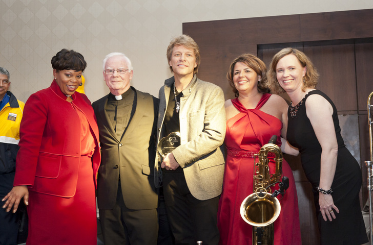 Mayor Redd, Monsignor Michael Doyle, Jon Bon Jovi, Helene Pierson from Heart of Camden, and Pilar Hogan from Saint Joseph's Carpenter Society