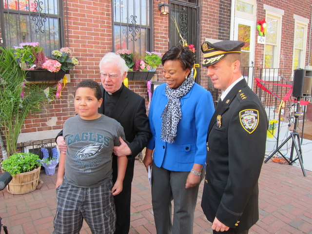 Jorge, Father Doyle, Mayor Redd, and Chief Thompson at the Ribbon Cutting for Heart of Camden