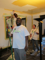 Day 2: Volunteer Terrance Helps Paint One of the Homes