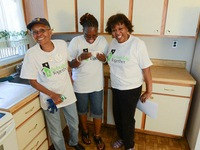 Day 3: Mother, daughter & Friend all share in the moment of seeing remodeled kitchen for first time