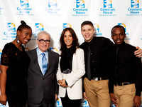 Martin Scorsese and Olivia Harrison with some of the Covenant House Youth performing that evening