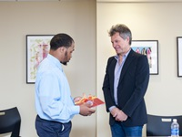 Jon Bon Jovi receiving a gift of thanks from the youth from Covenant House PA who have moved in to their new apartments in JBJ Soul Homes.
