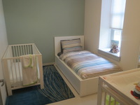 A bedroom for a mom and her baby in one of the Apartments in Merrick Hall